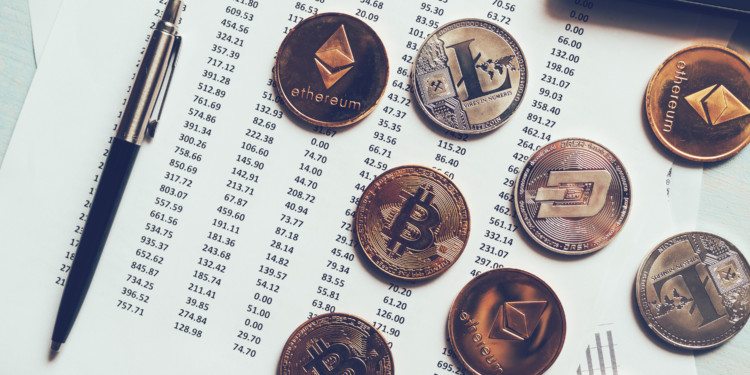 Cryptocurrency coins with exchange rate table, various crypto money on business office dek